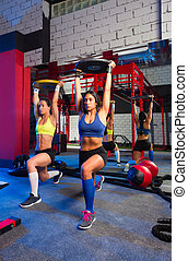 Gym women barbell plates rising workout exercise together