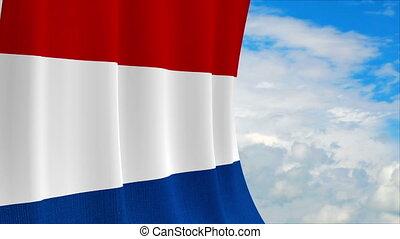 Netherlands flag on sky background