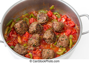 Meatballs cooking in a sauce - Homemade meatballs cooking in...