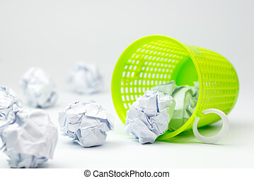 Trash bin and crumpled paper balls - Green trash bin and...