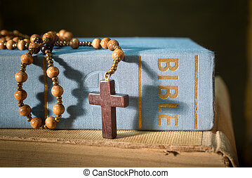 Bible And Rosary - detail of bible with rosary on the table