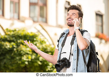 Tourists - Portrait of happy, young man, tourists with...