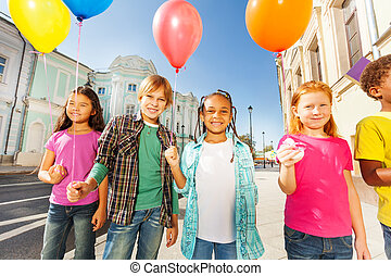 International group of children with balloons