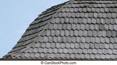 Black cedar wooden shingle roofs of a house FS700 4K - Black...