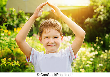 Little boy holding your hand forms a roof and symbolizes the...