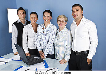 Cheerful business people in a office - Group of five...