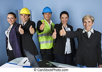Engineer team giving thumbs up - Five engineers team give...