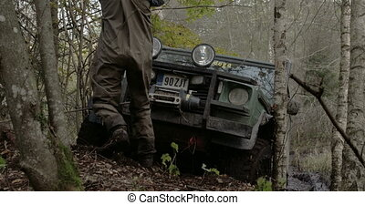 Pulling off a 4x4 offroad vehicle stuck on the tree With the...