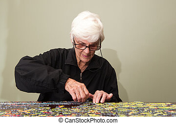 Jigsaw puzzle put together by an eldery woman - A thousand...