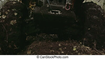 The muddy 4x4 offroad vehicle stuck in the muddy forest...