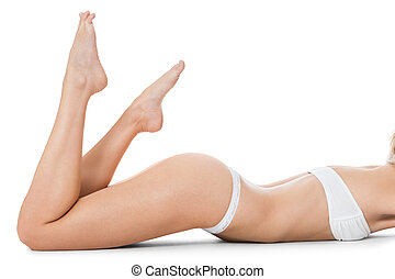 Nude lady in an aesthetic pose sitting on a white background...