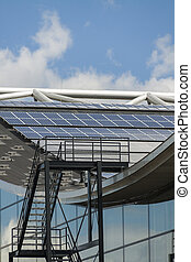 Photovoltaic solar panels on a roof for converting the solar...