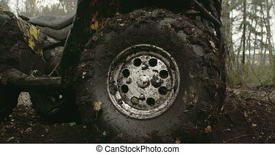 The muddy left wheel of the offroad vehicle FS700 4K - The...
