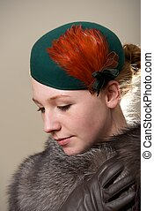 Redhead in green feathered hat and fur
