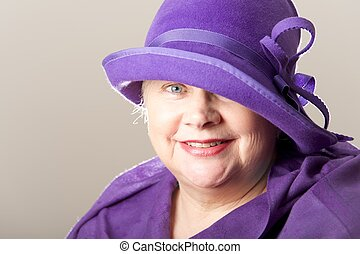 Close-up of white-haired woman in purple hat