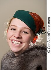 Laughing redhead in green hat and fur