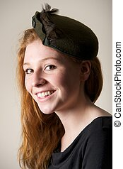 Laughing redhead in green hat with bow