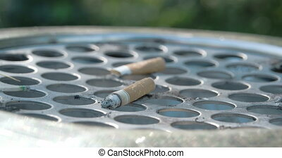 Close up view of the cigarette butt on the bin FS700 4K -...