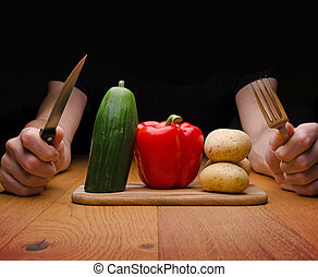 Vegetarian food - A man with vegetarian food on a wooden...