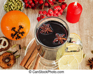 Mulled wine with spices on wooden table sample text