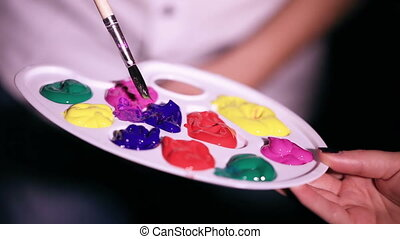 Palette of paints - Sample paint brush in a palette of...