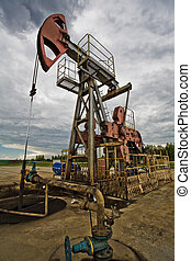 Oil pump in the field - Closeup of Oil pum in the fields...