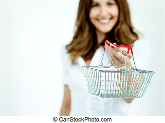 Smiling woman showing the shopping cart - Middle aged woman...