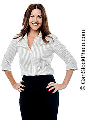 Smiling businesswoman with hands on hips - Confident...