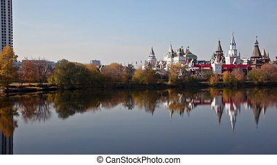 Izmaylovsky Kremlin which is reflected in water, panning...