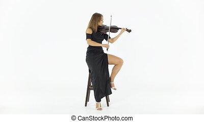 Girl playing the fiddle - Girl inspiringly playing the...