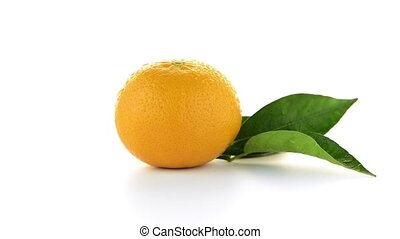 Ripe tangerine or mandarin isolated on white background