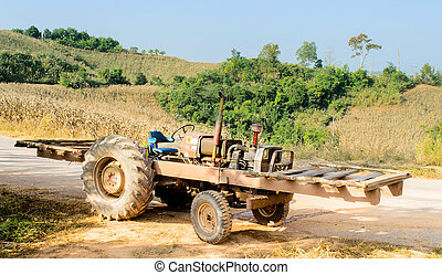 Unloaded Motor Truck beside Cornfield on Hill - The Unloaded...