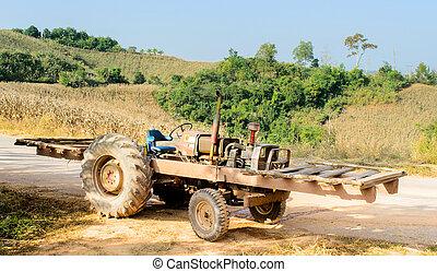Unloaded Motor Truck beside Cornfield on Hill - The Unloaded...