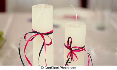 beautiful white candles on a table