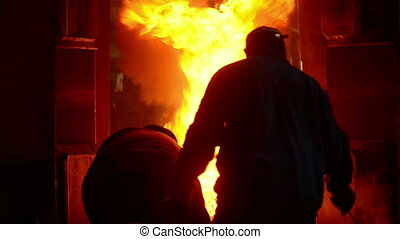 Industrial workers at the factory creating iron