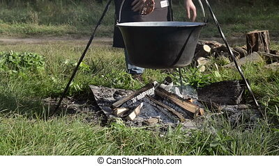 Cooking stew at the camp closeup footage