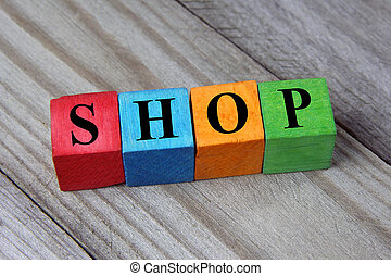 concept of shop word on wooden colorful cubes