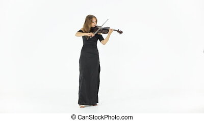 Beautiful girl in a long black dress playing the violin -...