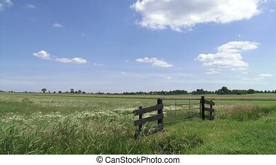 country gate in Dutch peat bog landscap - country gate in...