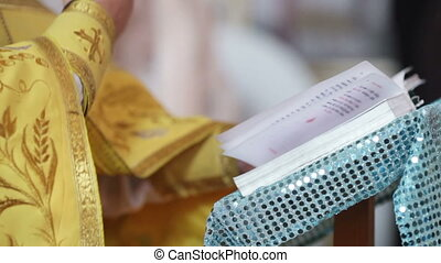 Evensoning Bible - Priest holding an open Bible and praying