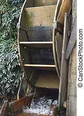 Watermill - Antique wooden watermill with spinning blades...