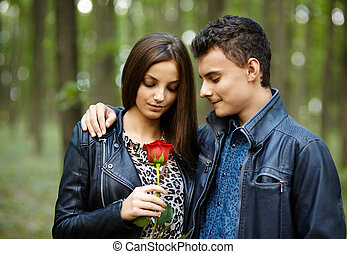 Teenager giving a flower to his girlfriend