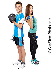Teens doing fitness - Two teenagers boy and girl doing...