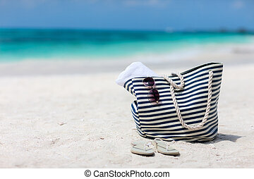 Beach vacation - Bag with beach towel, sun glasses and flip...