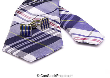 Tie and Cufflinks - Two cufflinks on a tie.
