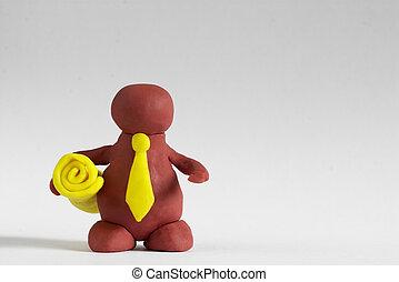 Plasticine man keeping a yellow roll over grey background