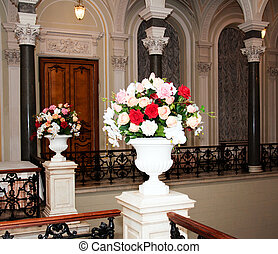 beautiful chandelier and a vase of flowers in the palace