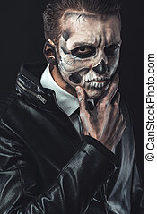 Portrait of pensive man with make-up skull - Portrait of...