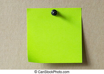 Sticker note - Green sticker note with a black push-pin over...