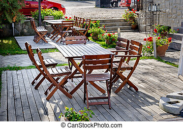 Empty outdoor cafe table - Empty outdoor cafe wooden table...